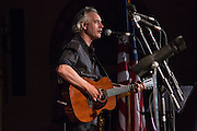 Emcee John Wesley Harding performing at the Folk City benefit concert at the Museum of the City of New York. The concert was held to support a forthcoming exhibit on the folk msusic revival in New York in the 1950s and 60s.