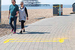 © Licensed to London News Pictures.09/04/2020. Brighton, UK. Brighton and Hove beach office have spray painted a 2 metres distance on the promenade to advise people to the social distancing. Photo credit: Hugo Michiels/LNP