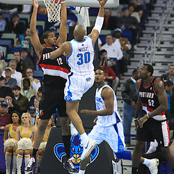 02 February 2009:  Portland Trailblazers forward LaMarcus Aldridge (12) defends New Orleans Hornets forward David West (30) during a 97-89 loss by the New Orleans Hornets to the Portland Trail Blazers at the New Orleans Arena in New Orleans, LA.