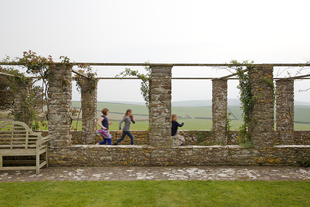 Running in the rose arbour at Pickwell Manor. From left to right: Liza Baker (9), Molly Elliott (10), Milly-grace (8). Pickwell Manor, Georgeham, North Devon, UK.<br /> CREDIT: Vanessa Berberian for The Wall Street Journal<br /> HOUSESHARE