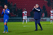 Glyn Hodges of AFC Wimbledon (Manager) claps the away fans during the The FA Cup match between Doncaster Rovers and AFC Wimbledon at the Keepmoat Stadium, Doncaster, England on 19 November 2019.