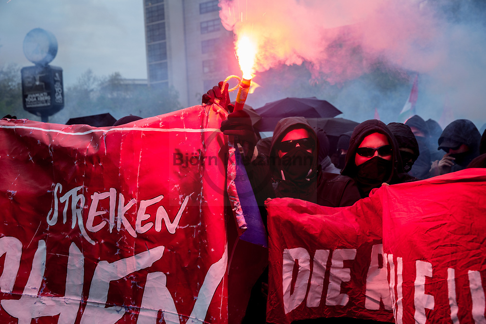 Berlin, Germany - 01.05.2017<br /> <br /> Protestors burn pyrotechnics. Thousands of people participate in the revolutionary 1st May demonstration in Berlin-Kreuzberg. The demo, traditionally starting at 6 pm, was not registered this year. Particularly<br />  at the end of the demonstration, bottles were thrown and police forces arrest several protestors.<br /> <br /> Demonstranten brennen Pyrotechnik ab. Tausende Menschen beteiligen an der revolutionaeren 1.Mai Demonstration in Berlin-Kreuzberg. Die traditionell um 18 Uhr beginnende Demo wurde in diesem Jahr nicht angemeldet. Insbesondere am Ende dem Demonstration kam es zu Flaschenwuerfen und Festnahmen.<br /> <br /> Photo: Bjoern Kietzmann