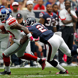October 10, 2010; Houston, TX USA; New York Giants wide receiver Hakeem Nicks (88) breaks a tackle by Houston Texans cornerback Brice McCain (21)during the first half at Reliant Stadium. Mandatory Credit: Derick E. Hingle