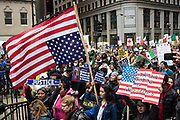 Demonstrators walk into Daley Plaza during a May Day march in Chicago on May 1, 2017. Thousands gathered for May Day, also known as International Workers' Day, in support of worker and immigrant rights.