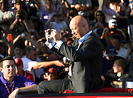 COOPERSTOWN, NY - JULY 26:  Hall of Famer Cal Ripken Jr. takes photos of the fans during the annual Parade of Legends down Main Street in Cooperstown, New York on July 26, 2014.