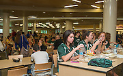 Students and parents take a break from orientation and enjoy lunch in the new Dining Court at Nelson dining hall on July 23, 2013.  Photo by Elizabeth Held