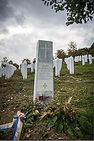 Rudolf Hren was killed in 1995, though it wasn&rsquo;t until 2010 that his body was found and exhumed from a mass grave in the Bosnian countryside. Hren was one of about 8,000 people, almost all of them men and boys, slaughtered over several days that July by Bosnian Serbs around Srebrenica, the worst atrocity in Europe since World War II. Except for four Catholics, all those killed were Muslim, and most of the dead are now buried at the Srebrenica-Potočari Memorial and Cemetery, which is nestled in hills that remind me of east Tennessee.<br /> <br /> Hren&rsquo;s is the only Christian (Catholic) grave in the cemetery. He grew up and lived in Srebrenica with his Muslim neighbors. After his body was identified and the decision needed to be made about where to bury him, his mother Barbara said, &ldquo;He was with them, he died with them. He should rest with them, too.&rdquo; Hren&rsquo;s wife Hatidža and daughter Dijana agreed.<br /> <br /> I spent several hours in this cemetery over two days. I watched women visit the graves of their husbands. I saw one man wander throughout the cemetery, visiting headstone after headstone and praying at each, hurt still in his eyes. Watching him was heartbreaking, and I assumed that each stop was someone important to him &mdash; a friend, a neighbor, a loved one &mdash; and that he had spent the last 18 years without them because people, some with crosses tattooed on their arms or chest, had slaughtered them.<br /> <br /> And so I was thankful for Rudolf Hren and his family, that by being one of the slaughtered, and by choosing to be buried here, a cross would not just be associated with those who did the killing. It would also be identified with someone who shared in the suffering.<br /> <br /> http://www.rferl.org/a/27114531.html