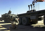 SOLDIERS PRAYER.A soldier kneels in prayer after a memorial ceremony for three soldiers from the 3rd Brigade who were killed when two Stryker vehicles rolled over into an irrigation canal near Samarra, Iraq.