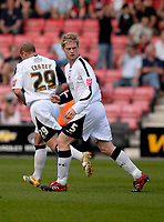 Photo: Leigh Quinnell.<br /> AFC Bournemouth v Swansea City. Coca Cola League 1. 14/04/2007. Swanseas Alan Tate looks back after scoring his goal.