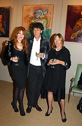 Left to right, MISS CHARLOTTE TILBURY and her parents, artist LANCE TILBURY and PATSY TILBURY at an exhibition of recent work by artist Lance Tilbury held at the Old Imperial Laundry, Warriner Gardens, Battersea, London on 7th December 2004.<br />
