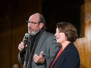 26 JANUARY 2020 - AMES, IOWA: US Senator AMY KLOBUCHAR (D-MN), right, listens to DAVID JOHNSON, a former Republican legislator who switched to Democrat after Donald Trump became the Republican candidate in 2016, endorse her during a campaign event in Ames. Sen. Klobuchar campaigned to support her candidacy for the US Presidency Sunday in central Iowa during the one day break from the impeachment trial of President Trump. She is trying to capitalize on her recent uptick in national polls. Iowa holds the first selection event of the presidential election cycle. The Iowa Caucuses are Feb. 3, 2020.    PHOTO BY JACK KURTZ