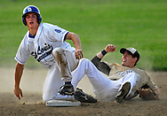 25 MAY 2010 -- FLORISSANT, Mo. -- Hazelwood Central High School infielder David Goering (18, right) reacts after St. Louis University High School's Alex Goedeker (12, left) attempted to break up a double play at Hazelwood Central Tuesday, May 25, 2010. Goedeker was called for interference on the play. SLUH won, 12-0. Photo © copyright 2010 by Sid Hastings.