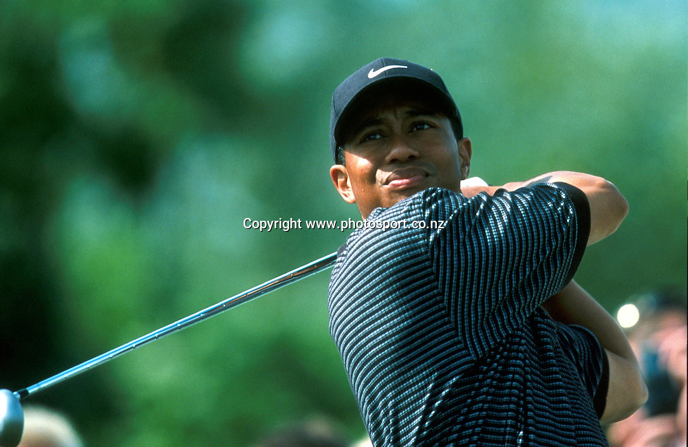 Tiger Woods (USA) hits out during the Deutshe Bank SAP Open, 2001. Photo: Sport the Library/PHOTOSPORT<br /><br /><br />124752