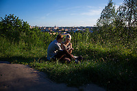 Vilnius, Lithuania- June 6, 2015: A couple enjoys a quiet moment as sun sets over the old town of Vilnius, which was recognized as an UNESCO World Heritage site in 1994. While much of the surrounding area still bears the marks of the Soviet days, the old town offers vibrant new offerings on a backdrop of Gothic, Renaissance, Baroque and classical architecture. CREDIT: Chris Carmichael for The New York Times