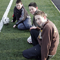 Michael Gavin, Daragh Queally and Niall Gavin watched from the sides lines during a soccer blitz at Lees Road on Saturday morning.<br /> <br /> Photograph by Yvonne Vaughan.