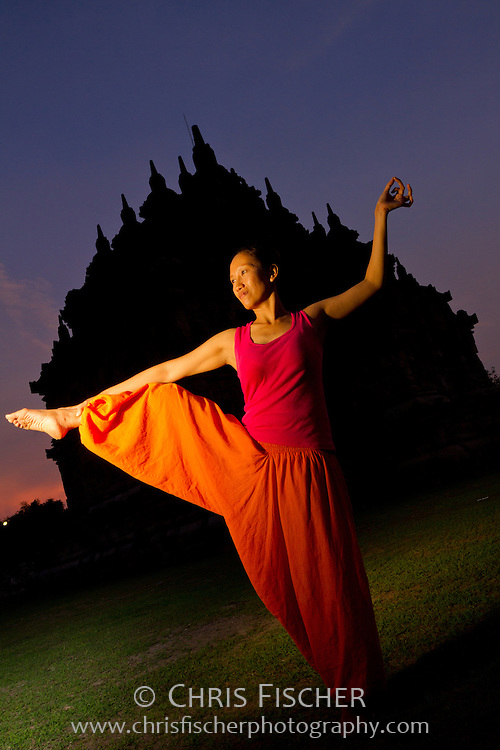 Bugis woman in traditional yoga poses at Ploasan Temple, Central Java, Indonesia.