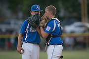 Cherry Hill's Joey Paolini talks to catcher Jake Babroff during a Section 4 Little League final against Cherry Hill held in Gloucester Sunday night.