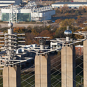 """View of """"Skystations"""" art implement above Kansas City Convention Center, with Kemper Arena in background. Kansas City, Missouri."""