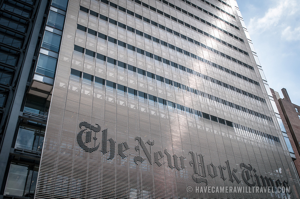 The facade of the New York Times Building in midtown New York, with a large rendering of the New York Times masthead.