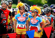 15 AUG. 2010 -- ST. LOUIS -- Dressed to resemble the chicken doll that has become their cycling team's mascot, Jackie Dozier (left) and Suzanne Renner wait with other riders for the start of the New Belgium Urban Assault Ride St. Louis in Forest Park in St. Louis Sunday, Aug. 15, 2010. Riders compete by racing to various locations throughout the city, where they are sometimes asked to perform activities to earn tokens and beads, which signify their completion of the course. The ride is a fundraiser for TrailNet and BicycleWORKS and is sponsored by Colorado brewer New Belgium. Image © copyright Sid Hastings.