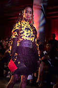 Runway fashion photo of African-American female model in dress by designer Chasity Sereal. Gerard Harrison Image Theory Photoworks.
