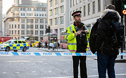 © Licensed to London News Pictures. 29/11/2019. London, UK. Police at the scene of an incident on London Bridge. There are reports of multiple stabbings and a possible shooting. Police are responding to the incident as though it is terror related as a precaution. Photo credit: Rob Pinney/LNP