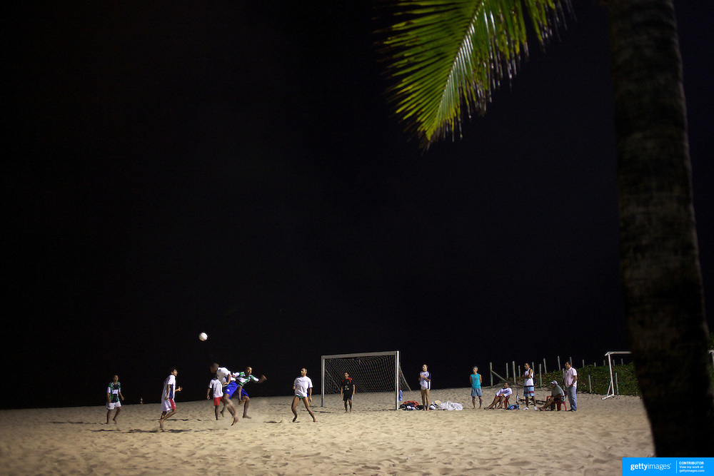 Locals play football at night time under floodlight on the beach at Ipanema beach, Rio de Janeiro, Brazil. 10th July 2010. Photo Tim Clayton...