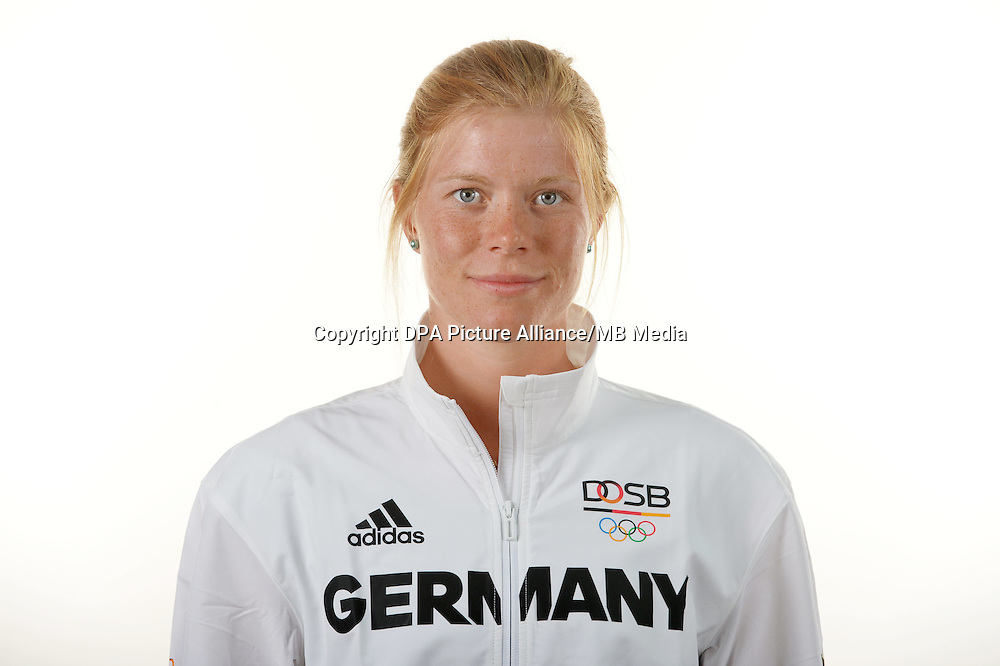 Annika Schleu poses at a photocall during the preparations for the Olympic Games in Rio at the Emmich Cambrai Barracks in Hanover, Germany. July 04, 2016. Photo credit: Frank May/ picture alliance. | usage worldwide