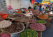 Selling fruit, spices and vegetables at Tomohon extreme market, north Sulawesi, Indonesia.