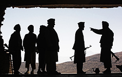AFG05-20010927-AFGHANISTAN: The fighters of anti-Taliban oppositional forces chat, looking at the mountains on their positions 25km from Afghan capital Kabul, 27 September, 2001. EPA PHOTO/SERGEI ILNITSKY