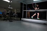 Dr. Laurence Ryan (left) and Andrew Udofa (center) look on as Ryan Hall runs at the SMU Locomotor Performance Lab in Dallas, Texas on March 18, 2016. (Cooper Neill for The New York Times)