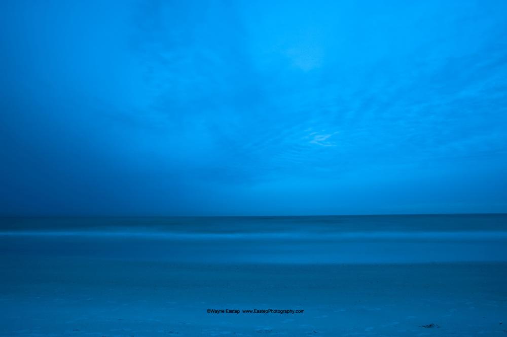 Beach, ocean and sky at dusk