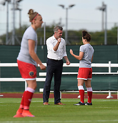 Bristol Academy manager Willie Kirk coaches Bristol Academy's Angharad James ahead of WSL game against Manchester City Women - Photo mandatory by-line: Paul Knight/JMP - Mobile: 07966 386802 - 18/07/2015 - SPORT - Football - Bristol - Stoke Gifford Stadium - Bristol Academy Women v Manchester City Women - FA Women's Super League