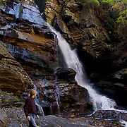 ASHEVILLE, NC: A hiker looks at a waterfall in Pisgah National Forest, in the Appalachian Mountains outside Asheville in North Carolina.(Photo by Logan Mock-Bunting) Sarah VDP hikes through Pisgah National Forest near Asheville, North Carolina.
