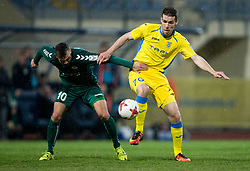 Denis Mojstrovic of Krka vs Luka Zinko of NK Domzale during football match between NK Domzale and NK Krka in Semifinal of Slovenian Football Cup 2016/17, on April 4, 2017 in Sports park Domzale, Slovenia. Photo by Vid Ponikvar / Sportida
