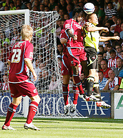 Photo: Steve Bond.<br />Scunthorpe United v Sheffield United. Coca Cola Championship. 01/09/2007. James Beattie (front) in an aeriel challange with Kelly Youga
