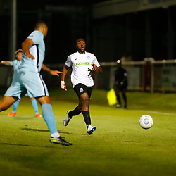 SEPTEMBER 12:  Top of the table Dover Athletic FChost eighth place Boreham Wood FC in Conference Premier at Crabble Stadium in Dover, England. The visitors, Boreham Wood  ran out winners a goal to nothing. Dover's defender Femi Ilesanmi focused on the ball. (Photo by Matt Bristow/mattbristow.net)