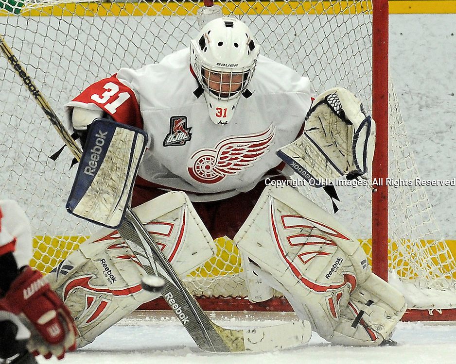 TRENTON, ON - Nov 10 : Ontario Junior Hockey League Game Action between Trenton Golden Hawks and the Hamilton Red Wings.  Mark Sinclair #31 of the Hamilton Redwings Hockey Club makes the save.<br /> (Photo by Phillip Sutherland / OJHL Images)