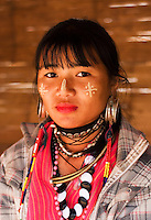 Young woman from Karen hill tribe with traditional jewellry & face markings, Tha Ton, Chiang Mai Province, Thailand