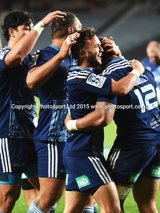 Blues players celebrate Moala's try during the Super Rugby match between The Blues and Bulls at Eden Park in Auckland, New Zealand. Friday 15 May 2015. Copyright Photo: Andrew Cornaga / www.Photosport.co.nz
