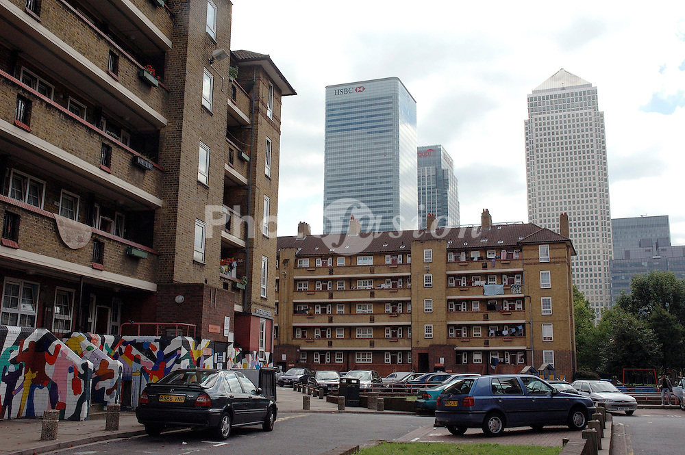 Peabody housing estate off Poplar High Street; Tower Hamlets; East London, Canary Wharf in background UK