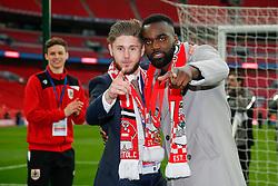 Wes Burns and Karleigh Osborne celebrate after Bristol City win the match 2-0 - Photo mandatory by-line: Rogan Thomson/JMP - 07966 386802 - 22/03/2015 - SPORT - FOOTBALL - London, England - Wembley Stadium - Bristol City v Walsall - Johnstone's Paint Trophy Final.