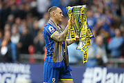AFC Wimbledon defender Barry Fuller (2) with the trophy after the Sky Bet League 2 play off final match between AFC Wimbledon and Plymouth Argyle at Wembley Stadium, London, England on 30 May 2016.