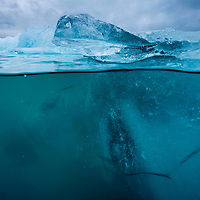 Iceland, Skaftafell National Park, Underwater view of Iceberg from Vatnajokull Glacier in Jokulsarlon Lake at dusk