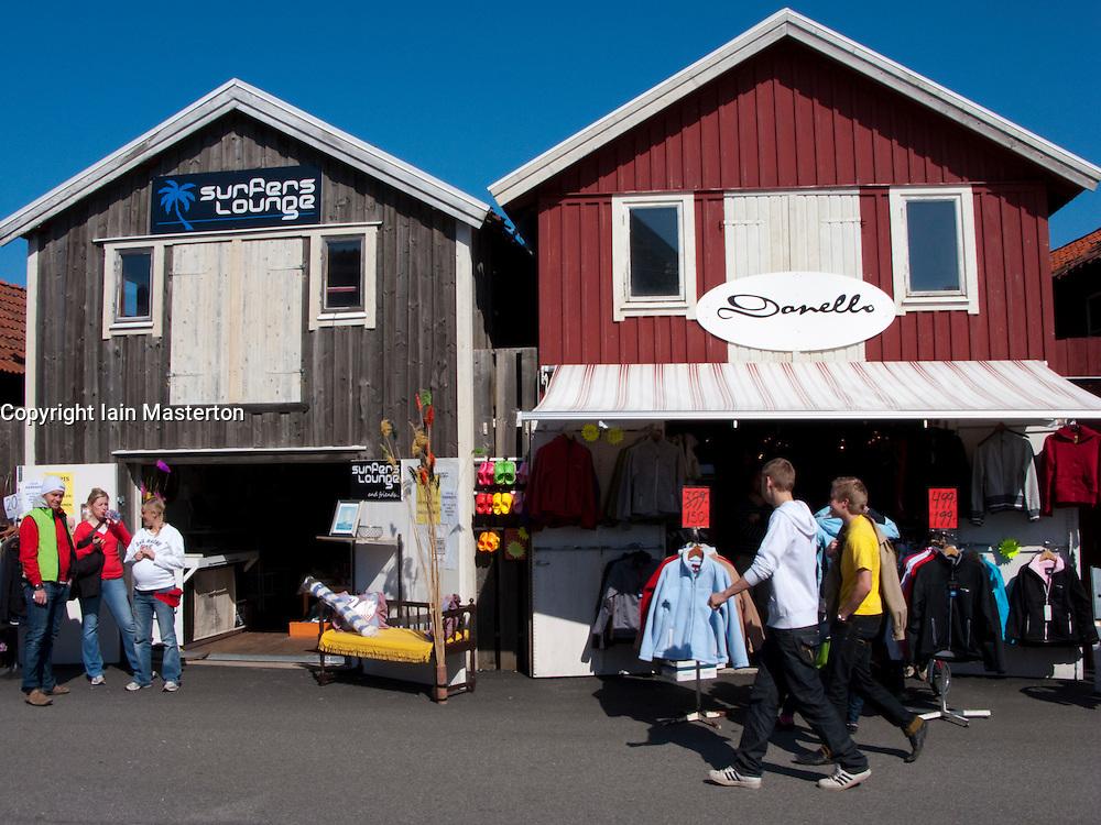 Shops in traditional red wooden buildings in village of Smogen on Swedens Bohuslan coast
