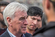 John Mcdonnell is interviewed by the media and talks to marchers - The May Day March from Clerkenwell Green ending with a rally in Trafalgar Square - against cuts and anti 'Trade Union laws. It was supported by several trade unions including UNITE, PCS, ASLEF, RMT, TSSA, NUT, FBU, GMB and UNISON as well as the Peoples Assembly, Pensioners' organisations and organisations representing migrant workers & communities.