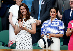 The Duchess of Cambridge and the Duchess of Sussex in the royal box on centre court after the Ladies Singles final on day twelve of the Wimbledon Championships at the All England Lawn Tennis and Croquet Club, Wimbledon.