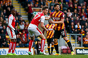 Fleetwood Town Defender, on loan from Preston North End, Ben Davies (37) keeps an eye on Bradford City defender Nat Knight-Percival (22)  during the EFL Sky Bet League 1 play off first leg match between Bradford City and Fleetwood Town at the Coral Windows Stadium, Bradford, England on 4 May 2017. Photo by Simon Davies.