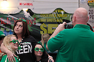 Erica Goins of Carlisle (left) stops for photo during the St. Patrick's Day celebration at Flanagan's Pub in downtown Dayton, Saturday, March 17, 2012.