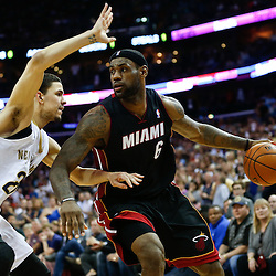 Mar 22, 2014; New Orleans, LA, USA; Miami Heat forward LeBron James (6) is guarded by New Orleans Pelicans guard Austin Rivers (25) during the second half of a game at the Smoothie King Center. The Pelicans defeated the Heat 105-95. Mandatory Credit: Derick E. Hingle-USA TODAY Sports